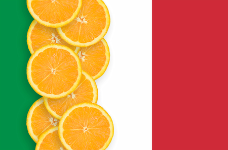 Italy flag and vertical row of orange citrus fruit slices. Concept of growing as well as import and export of citrus fruits