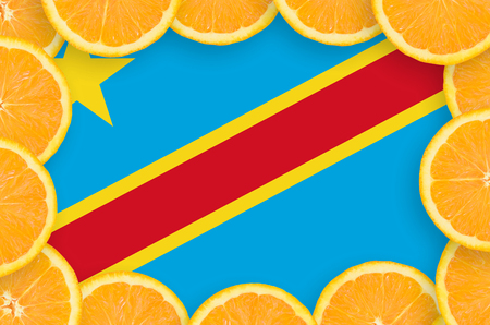 Democratic Republic of the Congo flag  in frame of orange citrus fruit slices. Concept of growing as well as import and export of citrus fruits