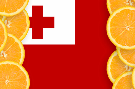 Tonga flag  in vertical frame of orange citrus fruit slices. Concept of growing as well as import and export of citrus fruits