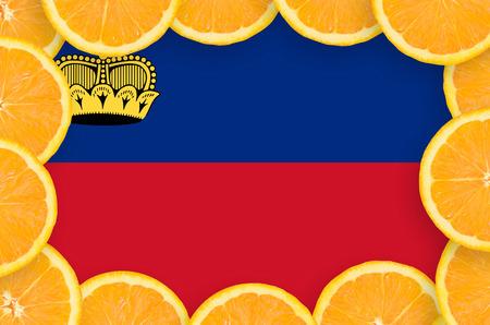 Liechtenstein flag  in frame of orange citrus fruit slices. Concept of growing as well as import and export of citrus fruits Banco de Imagens