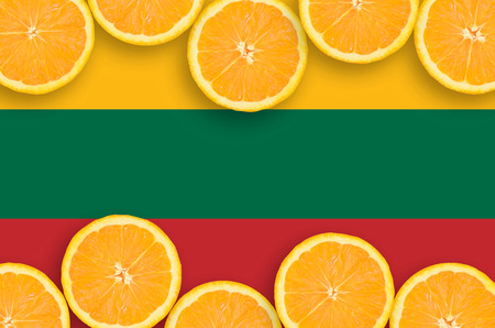 Lithuania flag  in horizontal frame of orange citrus fruit slices. Concept of growing as well as import and export of citrus fruits