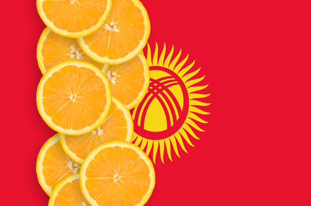 Kyrgyzstan flag and vertical row of orange citrus fruit slices. Concept of growing as well as import and export of citrus fruits