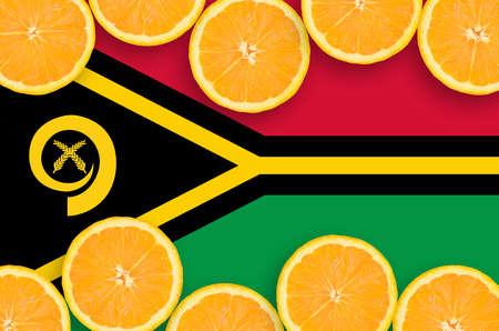 Vanuatu flag  in horizontal frame of orange citrus fruit slices. Concept of growing as well as import and export of citrus fruits