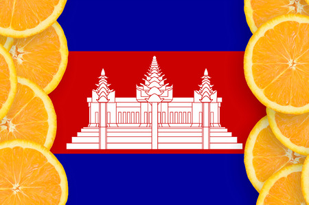 Cambodia flag  in vertical frame of orange citrus fruit slices. Concept of growing as well as import and export of citrus fruits
