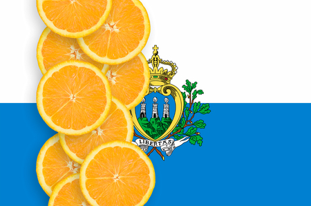 San Marino flag and vertical row of orange citrus fruit slices. Concept of growing as well as import and export of citrus fruits