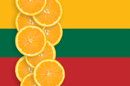 Lithuania flag and vertical row of orange citrus fruit slices. Concept of growing as well as import and export of citrus fruits
