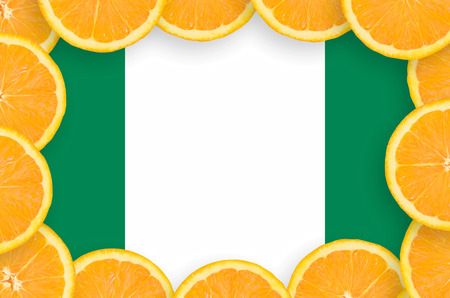 Nigeria flag  in frame of orange citrus fruit slices. Concept of growing as well as import and export of citrus fruits