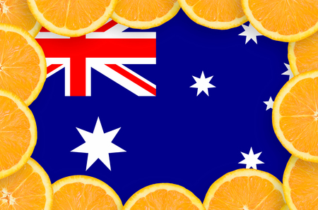 Australia flag  in frame of orange citrus fruit slices. Concept of growing as well as import and export of citrus fruits Stock Photo