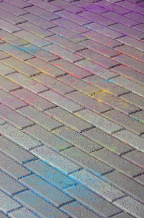 Multi colored earth, paving slabs, powder coated with dry colors at the Holi festival close up Stock Photo