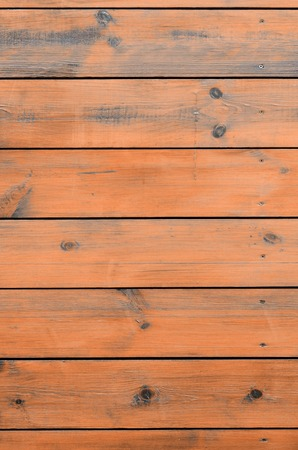 Varnished wood background from cabin exterior. Brown wood barn plank rough grain surface background