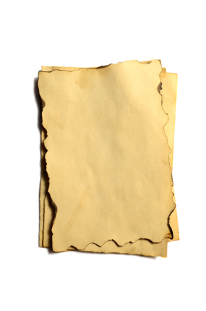 Few old blank pieces of antique vintage crumbling paper manuscript or parchment vertically oriented isolated on white 스톡 콘텐츠