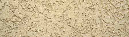 The texture of the beige decorative plaster in bark beetle style. Russian variation of decorating facade walls 版權商用圖片