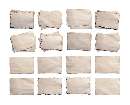 Set of old blank pieces of antique vintage crumbling paper manuscript or parchment horizontally oriented isolated on white 写真素材