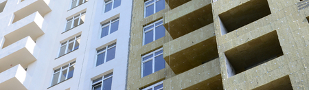 New city residential multi store apartement high building house facade under construction