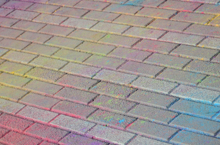 Multi colored earth, paving slabs, powder coated with dry colors at the Holi festival close up Stok Fotoğraf