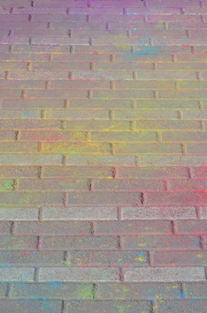 Multi colored earth, paving slabs, powder coated with dry colors at the Holi festival close up
