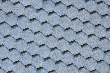 Modern roofing and decoration of chimneys. Flexible bitumen or slate shingles in hexagon shape. Top view texture Stock Photo