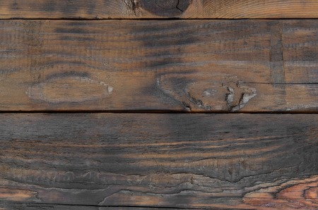 Background surface of dark brown wooden horizontal planks close up