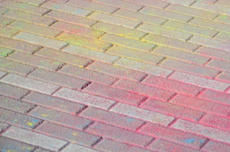Multi colored earth, paving slabs, powder coated with dry colors at the Holi festival close up Standard-Bild