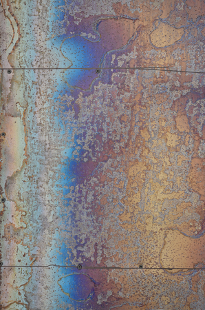 Abstract corrosion texture on the copper plated steel sheet. Random pattern in orange and blue colors