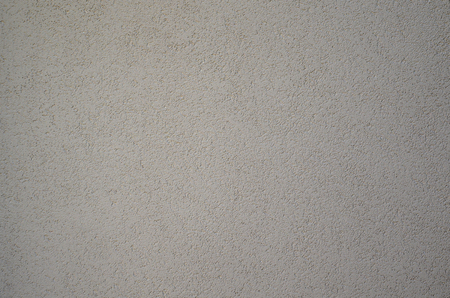 Texture of rough concrete wall with embossed texture. Smooth gray surface