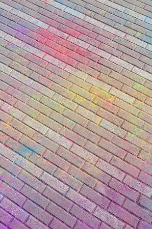 Multi colored earth, paving slabs, powder coated with dry colors at the Holi festival close up Banco de Imagens