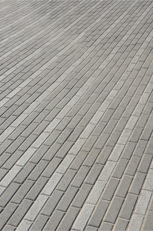 The road from the cobblestones in the town square. Background Texture in perspective
