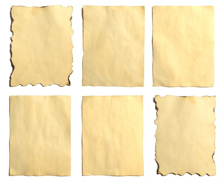 Set of old blank pieces of antique vintage crumbling paper manuscript or parchment vertically oriented isolated on white