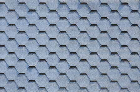 Modern roofing and decoration of chimneys. Flexible bitumen or slate shingles in hexagon shape. Top view texture