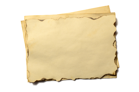 Few old blank pieces of antique vintage crumbling paper manuscript or parchment horizontally oriented isolated on white