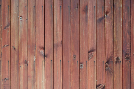Close up of brown wooden fence panels. Many vertical wooden planks as a full wall Stok Fotoğraf