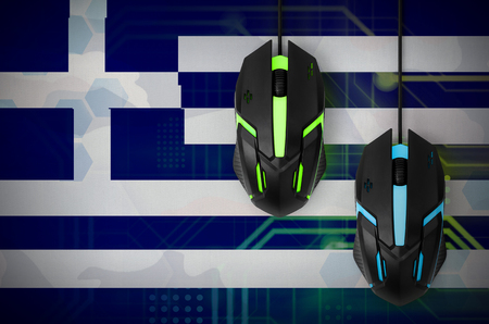Greece flag  and two modern computer mice with backlight. The concept of online cooperative games. Cyber sport team Banco de Imagens