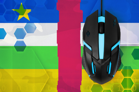 Central African Republic flag  and modern backlit computer mouse. Concept of country representing e-sports team