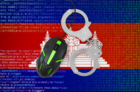 Cambodia flag  and handcuffed modern backlit computer mouse. Creative concept of combating computer crime, hackers and piracy Reklamní fotografie