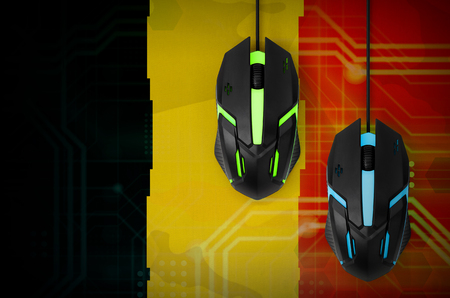 Belgium flag and two modern computer mice with backlight. The concept of online cooperative games. Cyber sport team