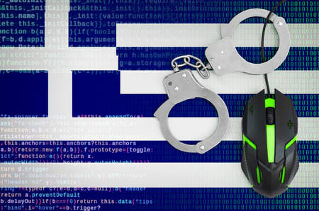 Greece flag  and handcuffed modern backlit computer mouse. Creative concept of combating computer crime, hackers and piracy