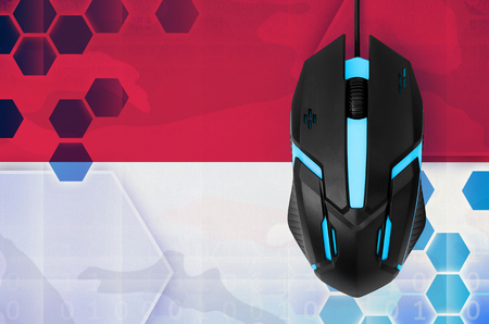 Indonesia flag  and modern backlit computer mouse. Concept of country representing e-sports team Banque d'images - 117310851