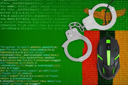 Zambia flag  and handcuffed modern backlit computer mouse. Creative concept of combating computer crime, hackers and piracy Archivio Fotografico