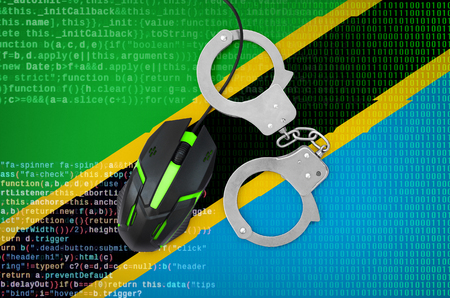 Tanzania flag  and handcuffed modern backlit computer mouse. Creative concept of combating computer crime, hackers and piracy