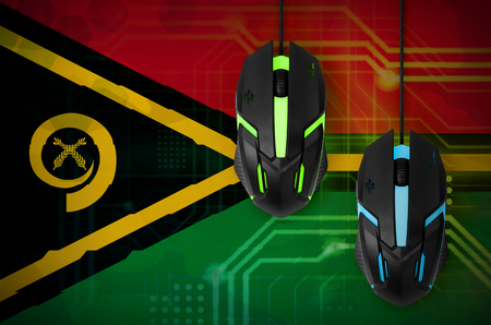 Vanuatu flag  and two modern computer mice with backlight. The concept of online cooperative games. Cyber sport team Banco de Imagens