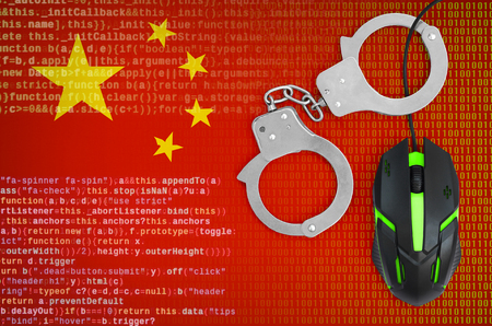 China flag  and handcuffed modern backlit computer mouse. Creative concept of combating computer crime, hackers and piracy 스톡 콘텐츠