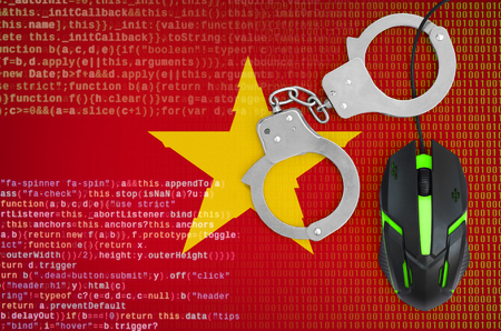 Vietnam flag  and handcuffed modern backlit computer mouse. Creative concept of combating computer crime, hackers and piracy Archivio Fotografico