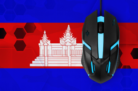 Cambodia flag  and modern backlit computer mouse. Concept of country representing e-sports team
