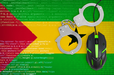 Sao Tome and Principe flag  and handcuffed modern backlit computer mouse. Creative concept of combating computer crime, hackers and piracy 免版税图像
