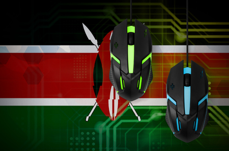 Kenya flag  and two modern computer mice with backlight. The concept of online cooperative games. Cyber sport team