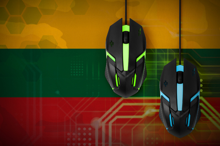 Lithuania flag  and two modern computer mice with backlight. The concept of online cooperative games. Cyber sport team