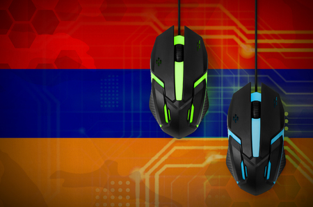 Armenia flag  and two modern computer mice with backlight. The concept of online cooperative games. Cyber sport team