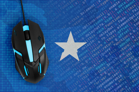 Somalia flag and modern backlit computer mouse. The concept of digital threat, illegal actions on the Internet