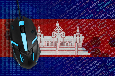 Cambodia flag  and modern backlit computer mouse. The concept of digital threat, illegal actions on the Internet Reklamní fotografie