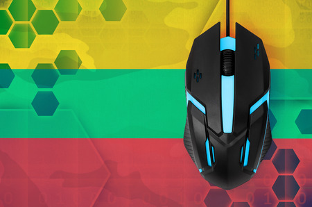 Lithuania flag  and modern backlit computer mouse. Concept of country representing e-sports team